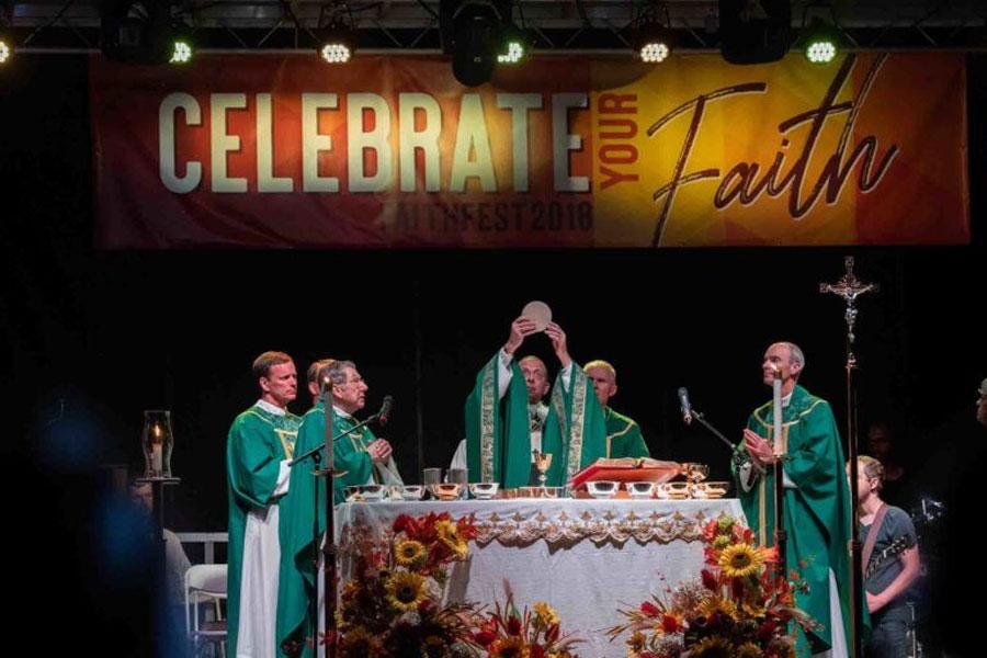 Archbishop Lori and priests celebrating Mass